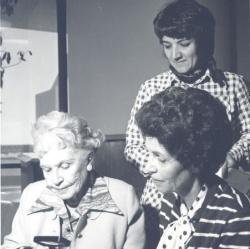 Anna Dean Kepper (standing) with donors Ruth Ferron and Shirley Ferron Swanson in 1975.