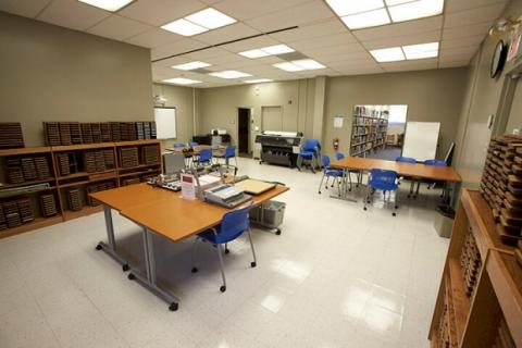 Teacher preparation lab showing tables with equipment and large format printer.