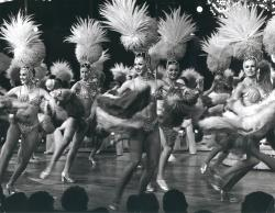 Example black and white photograph from the Showgirls digital collection of showgirls dancing on stage.