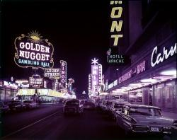 Example color photo from digital collections showing Fremont Street at night with many lit neon signs.