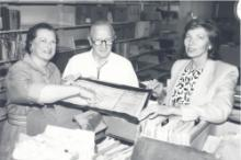 Susan Jarvis (right) with Mary Lou and Norton Williams working with boxes of files on July 29, 1987